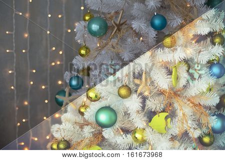 Photo before and after the image editing process. White decorative x-mas tree with colourful balls, vintage toned, christmas concept