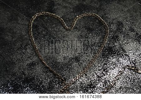 heart of Golden chain on fabric with gold flecks