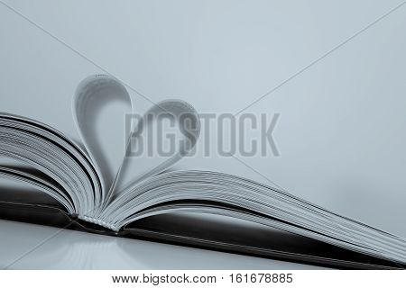 Abstract - paper heart from book sheets - romantic mood - background