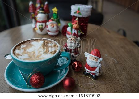 Christmas day and new year Santa Claus hot coffee heart foam on wooden table day time