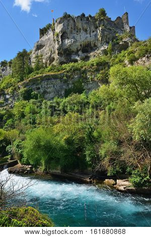 Beautiful Medieval Village Fontaine de Vaucluse and its castle on the river shore Provence France.The poet Petrarch made it his preferred residence in the 14th century