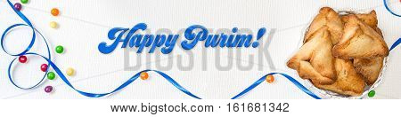 Purim banner with traditional cookies - hamantaschen and holiday greeting - Happy Purim