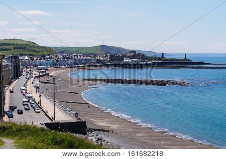 Elevated early summer view from part way up Constitution Hill of Aberystwyth an historic market town administrative centre and holiday resort within Ceredigion West Wales. It is located near the confluence of the rivers Ystwyth and Rheidol.