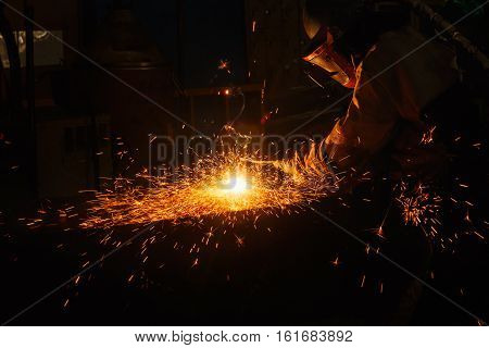 Welder arc Gouging carbon electrode rods with sparks and smoke