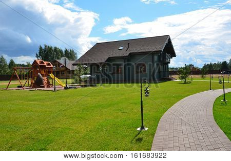 Country house.Landscape. Suburban house.The lawn in front of house
