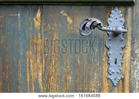 old wooden door with peeling old lock and fittings