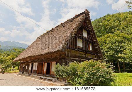 OGIMACI JAPAN - AUGUST 01 2016: Former Higahi Shina family residence (circa 19th c.) in Ogimachi gassho style village of Shirakawa-go district. World Heritage Site of