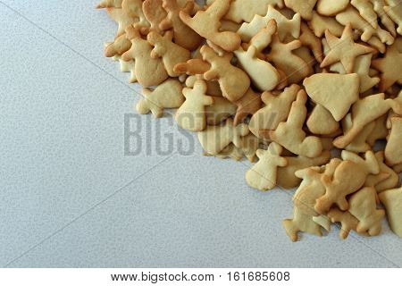 Overhead view of a large pile of Christmas sugar cut outs with room for copy