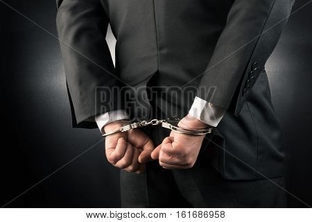 Businessman is arrested and handcuffed high quality and high resolution studio shoot