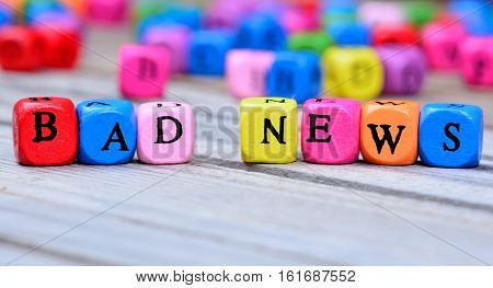 Bad news words on grey wooden table