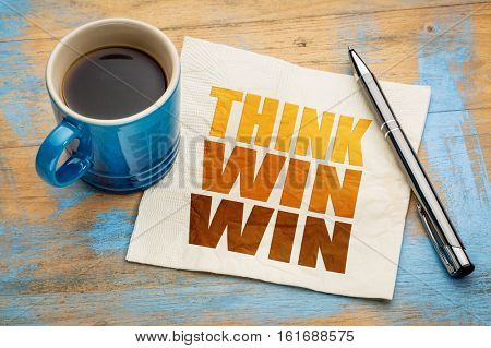 Think win-win concept  - word abstract on a napkin with cup of espresso coffee