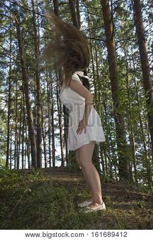 white women make fly hair in forest outdoors