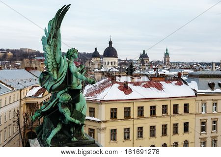 One of the three winged sculptures Wojtowicz. Sculpture music genius at the Lviv Opera and Ballet Theater dominates the town.