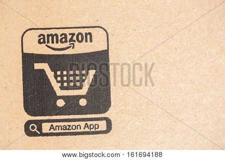 Paris France - December 15 2016: Amazon Prime Parcel Package. close-up on Ecommerce icon. Amazon is an American electronic commerce and cloud computing companybased in Seattle Washington. Started as an online bookstore Amazon is become the most importrant