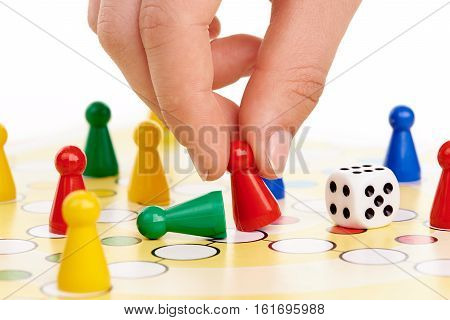 Board game with hand on white background
