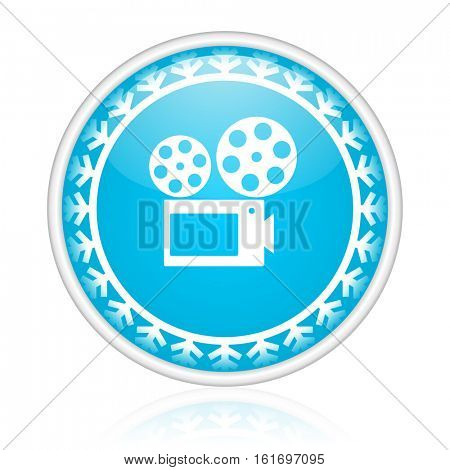 Cinema vector icon. Winter and snow design round web blue button. Christmas and holidays pushbutton.