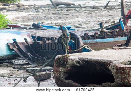 Broken abandoned fishing boat by the shore