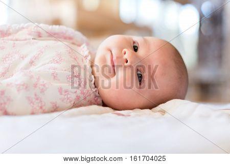 Baby Girl Lying On Her Blanket