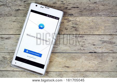 BUNG KAN THAILAND - SEPTEMBER 02 2015: smartphone on the table and facebook messenger on screen