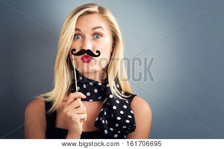 Young Woman Holding Paper Party Sticks