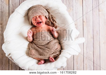 Crying Baby Boy In A Basket