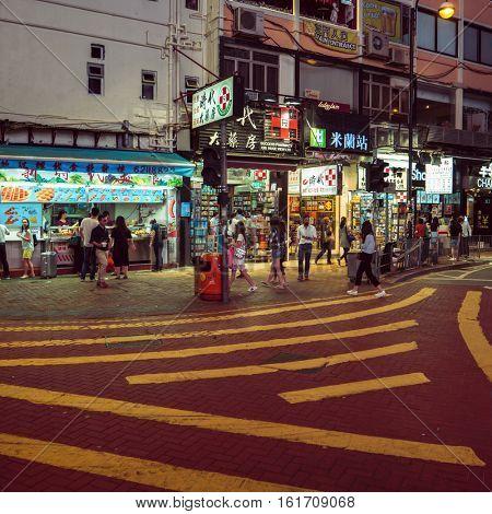 HONG KONG - October 2016: Street view with people and unusual crosswalk. Causeway Bay