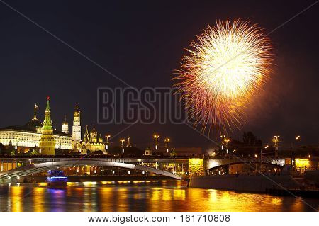 Moscow, Russia - Jun 12, 2010: Festive fireworks at the Moskva River embankmen near the Kremlin.
