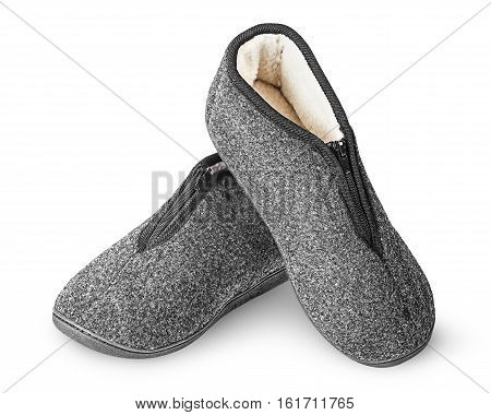 Dark gray slippers with fur one on another isolated on white background