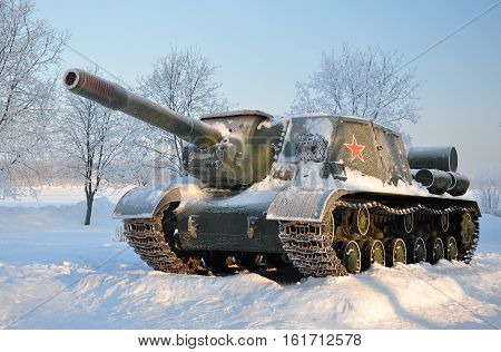 Old self-propelled artillery. After a snowfall. Russia