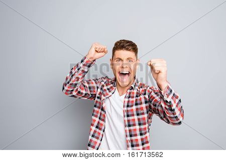 Excited Happy Successful Man Triumphing And Showing Fists