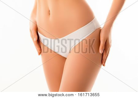 Close Up Photo Of Slim Woman In White Panties Touching Hips