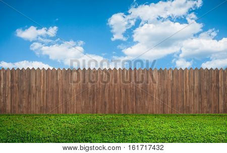 a wooden garden fence at the backyard