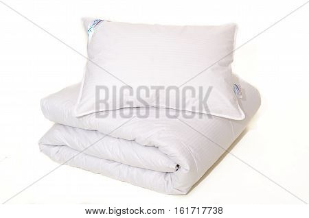 Rolled White Duvet Cover On  Isolated Background