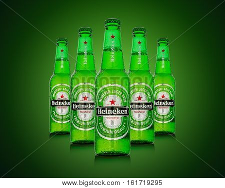 Editorial Photo Of Heineken Beer On Green Background. Path Included