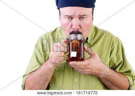 Unsure Man Tasting Cup Of Herbal Tea On White