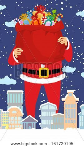 Santa Claus And Bag Of Gifts In City. Christmas In Town. Snow And Buildings. High Santa And Big Red
