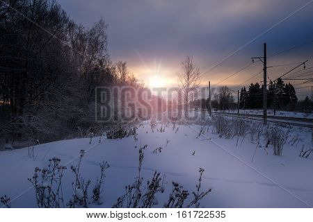 Railroad from winter forest at sunset, Russia