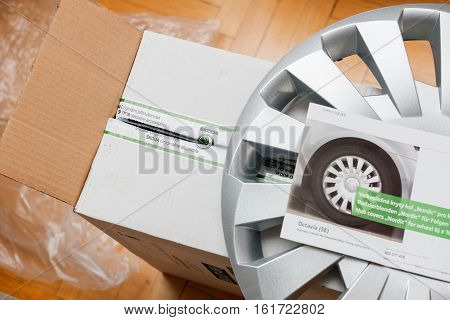 PARIS FRANCE - DEC 7 2016: Above view of unpacking modern hub covers for the winter tyres made by Skoda Auto for Skoda Superb Skoda OCtavia and Skoda Roomster - online internet shopping