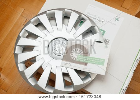 PARIS FRANCE - DEC 7 2016: Unpacking modern hub covers for the winter tyres made by Skoda Auto for Skoda Superb Skoda OCtavia and Skoda Roomster - online internet shopping