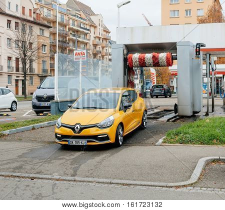 STRASBOURG FRANCE - DEC 2 2016:Clean Renault Clio sport yellow car leaving automatic car wash