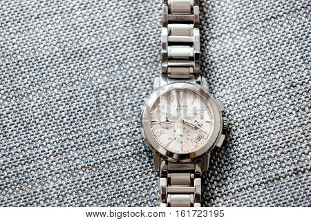 PARIS FRANCE - NOV 26 2016: Zenith male watch with broken destroyed sapphire glass waiting to be repaired