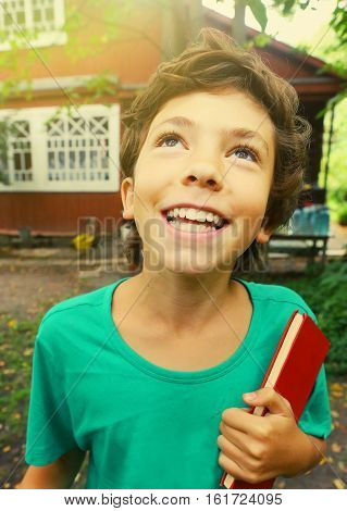 preteen handsome boy with book country summer close up portrait