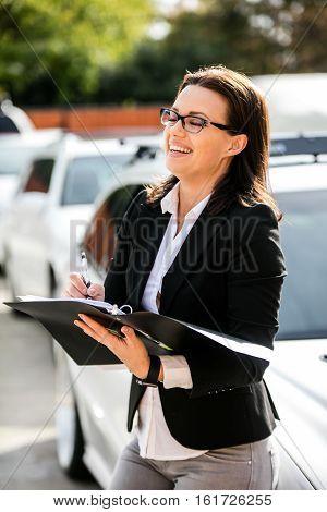 Business woman portrait on a drive way
