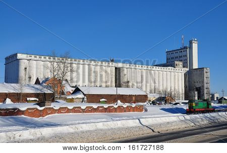 The elevator in the winter. Locomotive on the railroad. Winter.