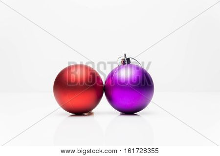 Two Christmas balls isolated on white background.