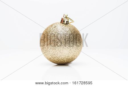 Gold Christmas ball isolated on white background.