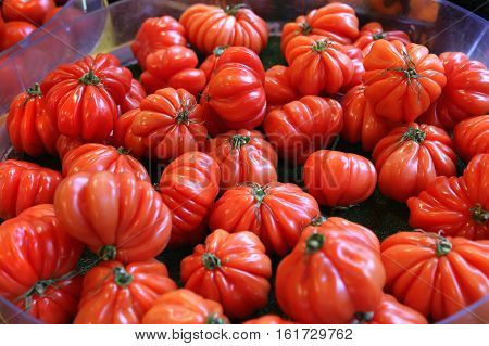 Delicious big red tomatoes at the market