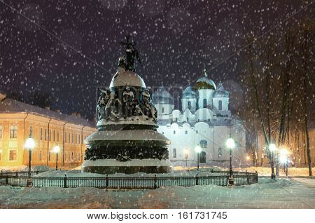 The monument Millennium of Russia on the background of the St. Sophia Cathedral in Novgorod. Winter night city landscape