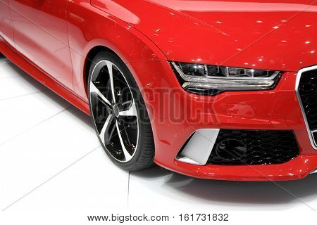 Head lamp of red sports car