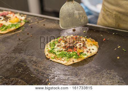 Japanese traditional food okonomiyaki or Japanese pizza